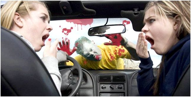 A zombie attacks a car in traffic.